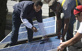 people installing solar panels
